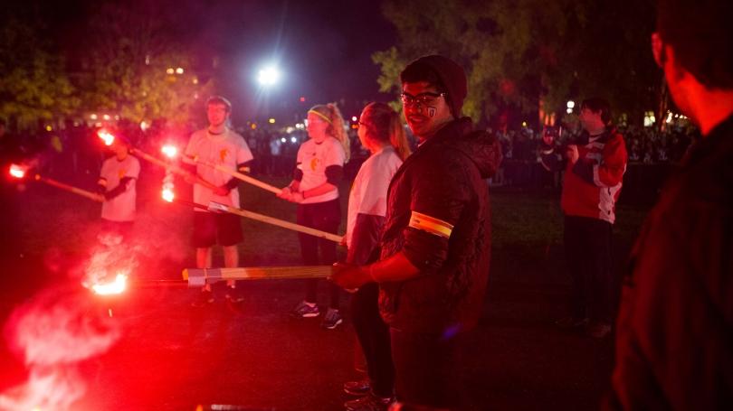 Students at homecoming bonfire.
