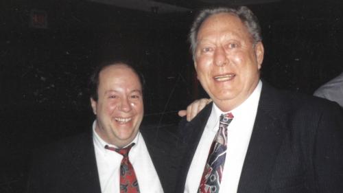 Former Director of Debate Ken Strange with coach Herb James.