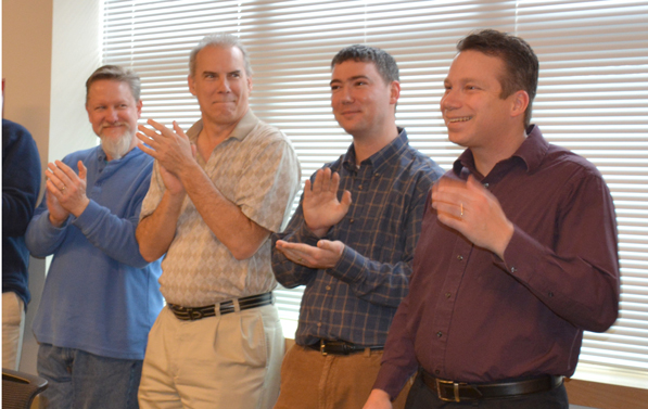 Nathan Paddock, far right, learns that he won the United Way grand prize.