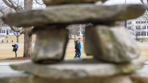 "Framing the Green, this inuksuk, or ""likeness of a person,"" was built by hand with stones from a field in Haverhill, N.H.,"