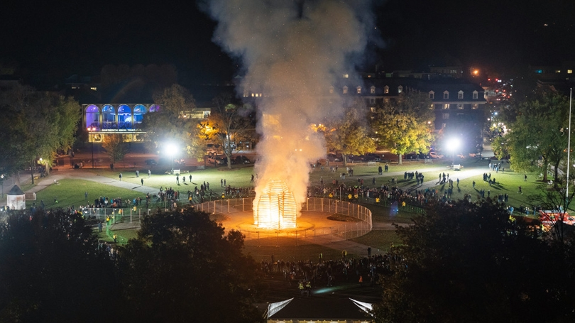 The bonfire lights up the night at last year's homecoming.