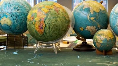 A collection of globes in the Evans Map Room, Baker-Berry Library