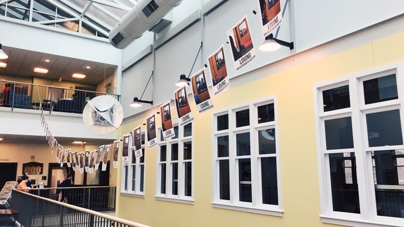 A banner of photos from the Pan Asian Community hangs inside Collis.