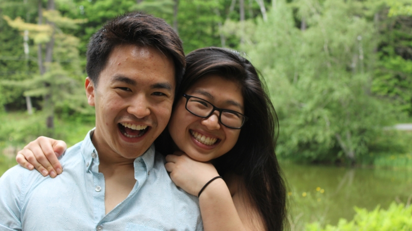 Two students smile by Occom Pond.