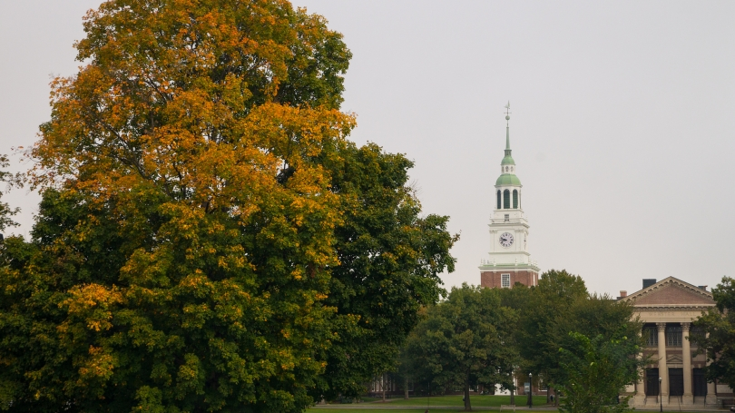 Photograph of the Dartmouth Green and Baker Tower during the fall foliage season.