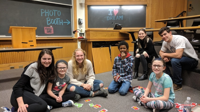 Group of mentors and mentees playboard game together in Rocky