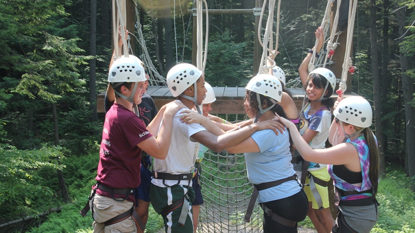 SEAD students traverse a ropes course.