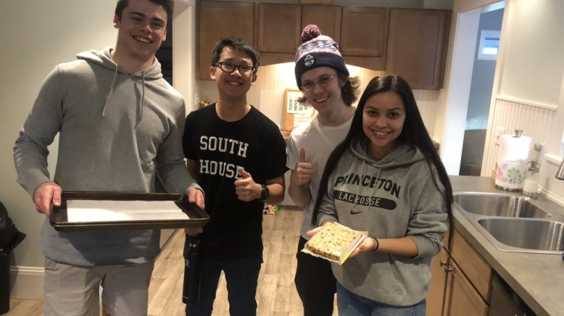 Students baking cookies for Maynard House guests