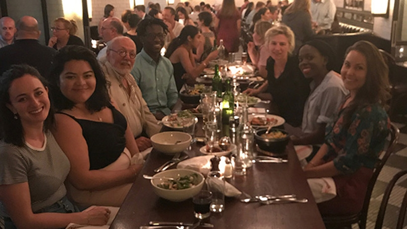 Alumni and students at a dinner table
