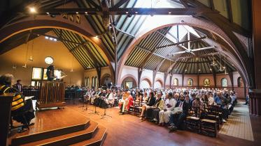 A student speaks to the crowd gathered inside of Rollins Chapel for the baccalaureate ceremony.