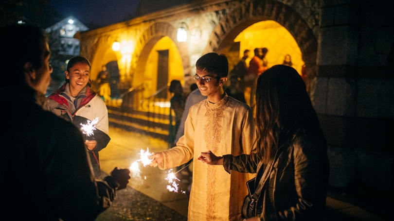 Students light candels during the Hindu Festival of Lights.