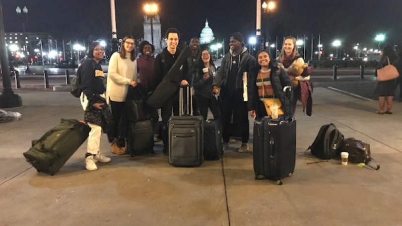 Students with suitcases arriving in DC for ASB  trip