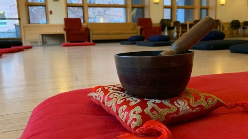 Meditation pillow with singing bowl