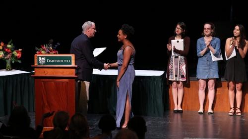 President Phil Hanlon '77 congratulates arts award winter Celeste Jennings '18