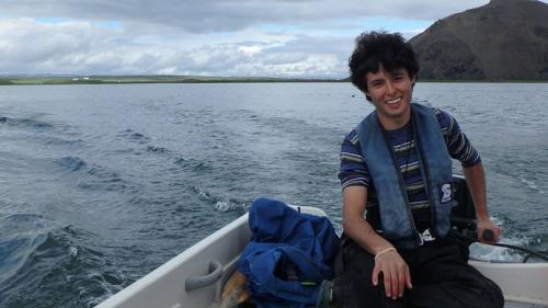 Aldo Arellano riding in a motorboat