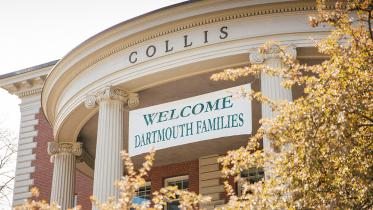 A banner welcoming families hangs from the Collis Center.