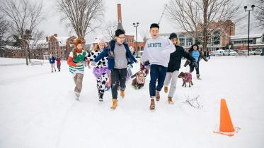 A group of students pull a sled during Winter Carnival.