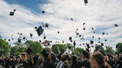 Students throwing their caps during Commencement ceremony.