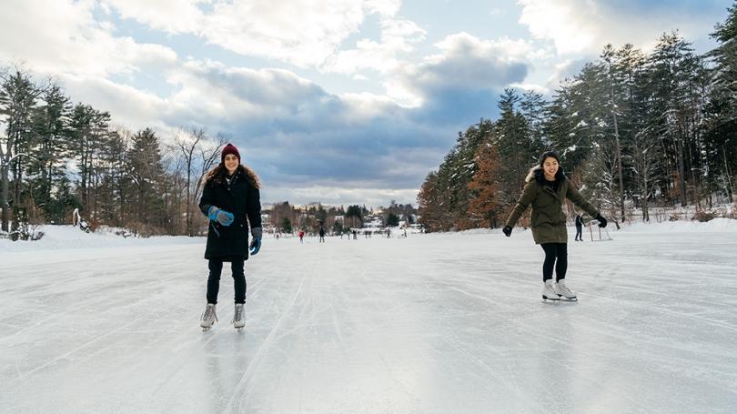 Students ice skate on frozen Occom Pond.