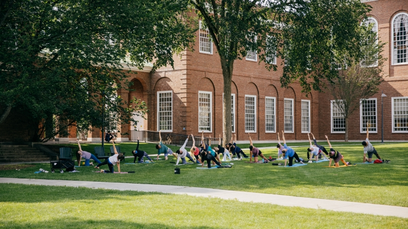 Outdoor yoga class on baker lawn