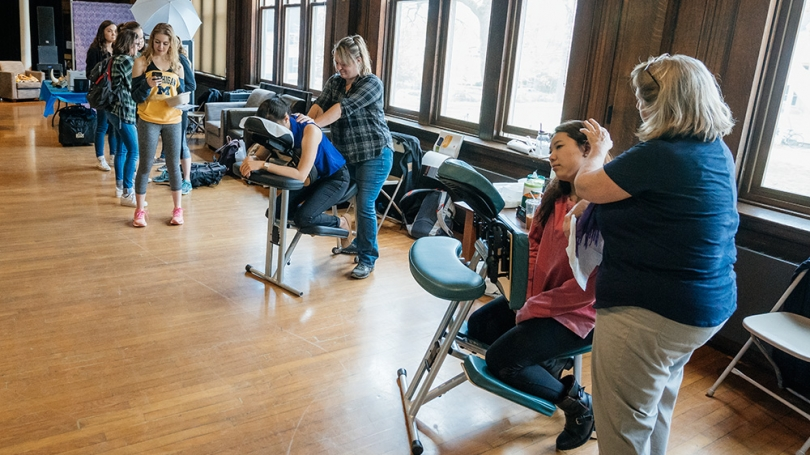 Students receive chair massages.