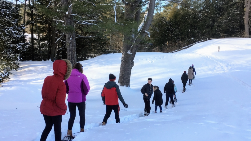 A group of students snowshoeing in Pine Park