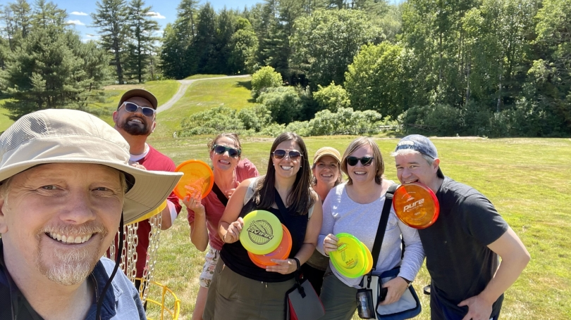 Group photo of SWC staff members at disc golf course