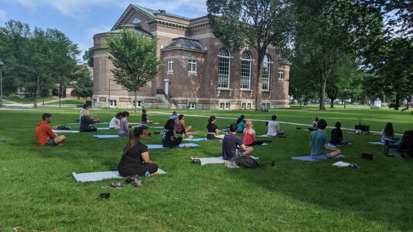 yoga class participants on Baker Lawn