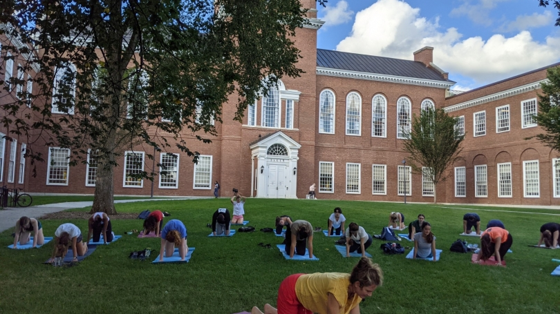 yoga instructor and students on Baker lawn for outdoor class