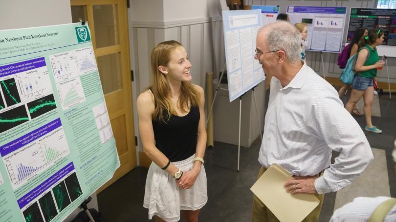 President Phil Hanlon at poster session.